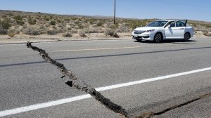 A large crack is seen going clear across a highway following an earthquake on July 4, 2019. (Credit: A crack in the road is seen near Ridgecrest, California after Thursday's quake. (Credit: Karaleigh Roe via CNN)