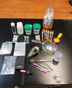 Loretto police released this photo of alleged drugs and paraphernalia seized after they served a search warrant.