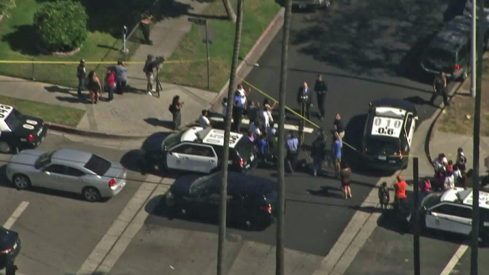 A crowd forms near where a woman was found fatally shot in an East Hollywood alley on July 18, 2019. (Credit: KTLA)