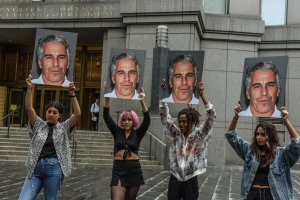 Protesters hold up photos of Jeffrey Epstein in front of the Federal courthouse on July 8, 2019 in New York City. (Credit: Stephanie Keith/Getty Images)