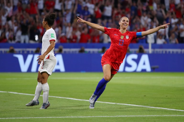Alex Morgan of the USA celebrates after scoring her team's second goal during the 2019 FIFA Women's World Cup France Semifinal match between England and USA at Stade de Lyon on July 2, 2019. (Credit: Richard Heathcote/Getty Images)