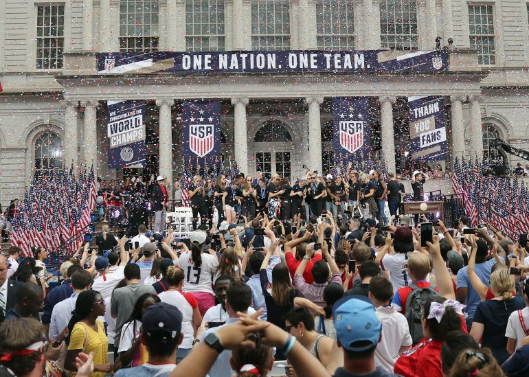 "Members of the United States Women's National Soccer Team are honored at a ceremony at City Hall on July 10, 2019, in New York City. The honor followed a ticker tape parade up lower Manhattan's ""Canyon of Heroes"" to celebrate their gold medal victory in the 2019 Women's World Cup in France. (Credit: Bruce Bennett/Getty Images)"
