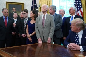 Apollo 11 astronaut Michael Collins (center) listens to NASA Administrator Jim Bridenstine (left) answer questions from U.S. President Donald Trump as they commemorate the 50th anniversary of the moon landing in the Oval Office at the White House, July 19, 2019, in Washington, D.C. (Credit: Chip Somodevilla/Getty Images)
