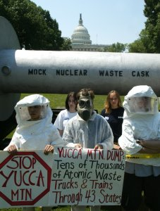 Protesters, dressed in protective clothing, stand in front of a mock nuclear waste cask, on Capitol Hill, June 18, 2002, in Washington, DC. (Credit: Mark Wilson/Getty Images)