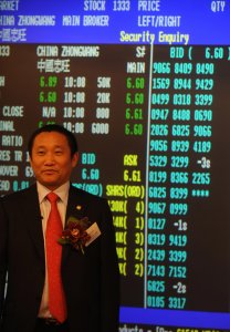 China Zhongwang Holdings Chairman Liu Zhongtian poses for pictures just after trading had started at the stock exchange in Hong Kong on May 8, 2009. (Credit: MIKE CLARKE/AFP/Getty Images)