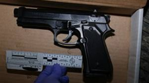 A handgun recovered at the scene of a fatal police shooting was determined to be a replica, prosecutors said.