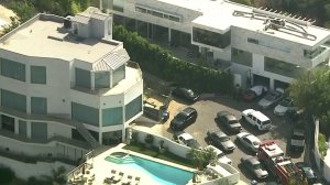 Rapper YG's Hollywood Hills home is seen being raided by sheriff's deputies on July 18, 2019. (Credit: KTLA)