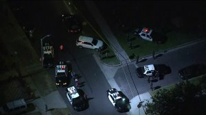 Los Angeles police work at the scene of a police shooting in the area of 47th Street and Budlong Avenue in South Los Angeles on July 26, 2019. (Credit: KTLA)