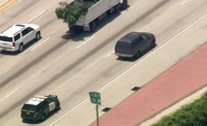 Officers are seen in pursuit of a driver on the northbound 405 in the West L.A. area on July 12, 2019. (Credit: KTLA)