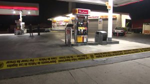 Police investigate a fatal shooting at a Shell gas station in North Hollywood on July 25, 2019. (Credit: KTLA)