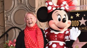 Voice actress Russi Taylor, who has voiced Minnie Mouse since 1986, poses with Minnie Mouse during a star ceremony in celebration of the 90th anniversary of Disney's Minnie Mouse at the Hollywood Walk of Fame on January 22, 2018 in Hollywood, California. (Credit: Alberto E. Rodriguez/Getty Images)
