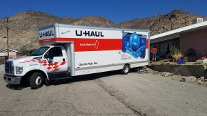 A U-Haul truck appears on a driveway in Trona where some residents are packing their belongings on July 8, 2019. (Credit: KTLA)