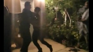 A man is seen physically fighting officers outside a home in San Fernando, July 28, 2019. (Credit: Onscene.TV)