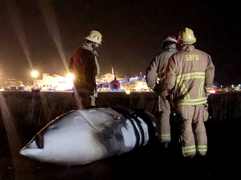 Seven people escaped unharmed after a C-130 airplane made an emergency landing and caught fire at Santa Barbara Airport on Aug. 25, 2019. (Credit: Santa Barbara County Fire Department)