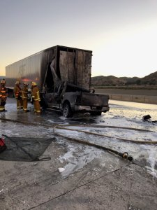 A a big rig and a pickup truck are seen in the middle of the northbound 5 Freeway in Castaic following a deadly crash on Aug. 14, 2019. (Credit: Caltrans District 7/Twitter)