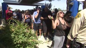 Parents waited outside as deputies searched San Dimas High School following a report of an armed person on campus. (Credit: KTLA)