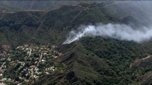 A fire burns in the Pacific Palisades area of Los Angeles on Aug. 13, 2019. (Credit: KTLA)