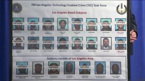 Photos of the suspects believed to have been involved in a cyber crime and money laundering network are displayed at a news conference in Los Angeles on Aug. 22, 2019. (Credit: KTLA)