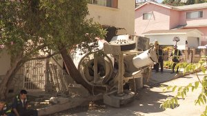 A cement truck smashed through the front of a home in L.A.'s Mt. Washington neighborhood on Aug. 31, 2019. No injuries were reported. (Credit: KTLA)
