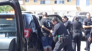 A teenage boy is taken into custody after leading authorities on a pursuit through North Hollywood on Aug. 17, 2019. (Credit: Loudlabs)