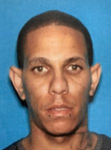 Robert Carrasquillo is seen in this booking photo from the Los Angeles Police Department.