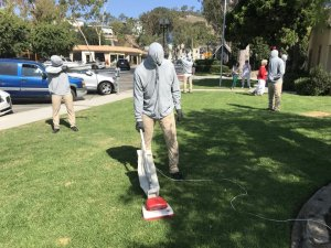 Realistic life-size characters, including this guy vacuuming the grass, are on display in front of Laguna Beach City Hall as part of a temporary installation by artist Mark Jenkins. (Credit: Don Leach / Daily Pilot via Los Angeles Times)