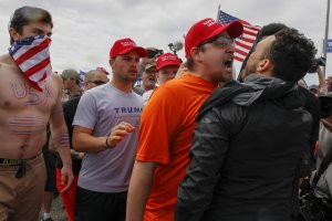 A scuffle breaks out at a Make America Great Again rally on Bolsa Chica State Beach in March 2017. (Credit: Irfan Kahn / Los Angeles Times)