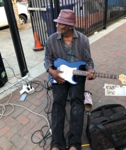 Dwayne Fields strums his guitar in an undated photo. (Credit: Los Angeles Times)