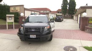 Garden Grove police on Aug. 7, 2019 investigate the death of a woman found inside a home. (Credit: KTLA)