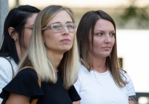 Alleged victims Annie Farmer, left, and Courtney Wild, right, leave the courthouse after a bail hearing in Jeffrey Epstein's sex trafficking case on July 15, 2019 in New York City. (Credit: JOHANNES EISELE/AFP/Getty Images)