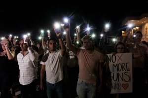 People hold their mobile phones with flash on during a vigil in Ciudad Juarez, Chihuahua state, in Mexico, on Aug. 3, 2019, after a mass shooting left 20 people dead in El Paso, Texas.(Credit: HERIKA MARTINEZ/AFP/Getty Images)
