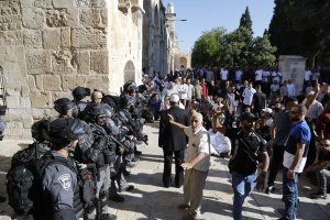 Palestinian Muslims face Israeli security forces as tensions rise inside the Al-Aqsa Mosque compound in the Old City of Jerusalem on August 11, 2019 (Credit: AHMAD GHARABLI/AFP/Getty Images)