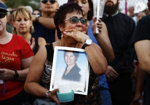Lupe Lopez carries a photo of Elsa Mendoza Marquez, a Mexican schoolteacher from across the border in Ciudad Juarez who was killed in the shooting, during an interfaith vigil for victims of a mass shooting, which left at least 20 people dead, on August 4, 2019 in El Paso, Texas. (Credit: Mario Tama/Getty Images)