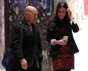 Retired Admiral James Stavridis, left, dean of Fletcher School at Tufts University, is escorted by Madeleine Westerhout as he arrives at Trump Tower in New York City on Dec. 8, 2016. (Credit: Dominick Reuter / AFP / Getty Images)
