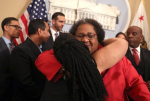California State Assemblywoman Shirley Weber (D-San Diego) is hugged by Tanya Faison of Black Lives Matter Sacramento during a news conference to announce new legislation to address recent deadly police shootings on April 3, 2018, in Sacramento, California. (Credit: Justin Sullivan/Getty Images)