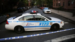 An NYPD police car is parked at a crime scene in Brooklyn on June 10, 2015. (Credit: Spencer Platt/Getty Images)