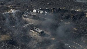 Three vehicles are burned at the site of a fire in Moreno Valley on Aug. 15, 2019. (Credit: KTLA)