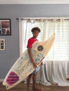 "Max Keliikipi said a shark ""bit a huge chunk off"" his board. (Credit: Courtesy Max Keliikipi)"