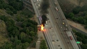 Flames engulfed a semitruck on the side of the northbound 5 Freeway in Santa Clarita on Aug. 14, 2019. (Credit: Sky5)