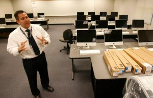 Then-Principal Perry Wiseman talks about the Colonel Rodriguez PREP Academy computer lab in a 2008 file photo. (Credit: Southern California News Group)