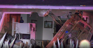 A gaping hole can be seen in a home in Beaumont after firefighetrs pulled out a pickup truck that crashed into it on August 3, 2019. (Credit: RMG News)