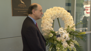 Congressman Brad Sherman is seen on Aug. 10, 2019, standing next to a plaque honoring Joseph Ilteto at a Chatsworth U.S. Postal office on the 20th anniversary of the shooting. (Credit: KTLA)