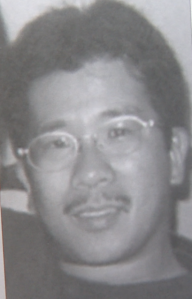 Joseph Ileto's photo is seen in a book a family member displayed at an event on Aug. 10, 2019. (Credit: KTLA)