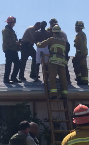 A nude burglary suspect was found hiding in the chimney of a Ladera Heights home on Aug. 11, 2019. (Credit: Ace Antonio Hall)