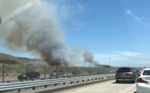 A fire burns along the 5 Freeway near Camp Pendleton on Aug. 17, 2019. (Credit: KTLA)