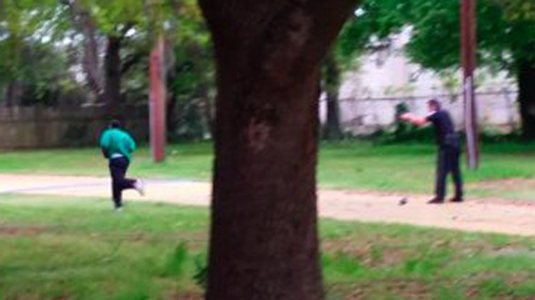 This still, released by the family of Walter Scott, shows North Charleston, South Carolina, police Officer Michael Slager shooting Scott in the back as he ran away from the officer on April 4, 2015.