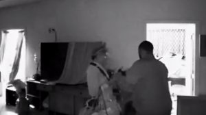 Surveillance footage shows a man and woman breaking into a Jefferson Park home that was undergoing tenting for fumigation on Aug. 15, 2019. (Credit: Melvin Barrientos)
