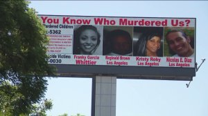 A digital billboard drawing attention to unsolved homicide cases was set up along the 605 Freeway in Baldwin Park on Aug. 24, 2019. (Credit: KTLA)