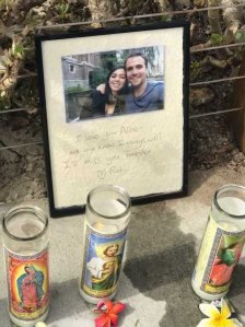 """A photo with a message that reads """"I love you Allie"""" sits on a makeshift memorial in Santa Barbara a day after dive boat burned near Santa Cruz Island on Sept. 2, 2019. (Credit: KTLA)"""