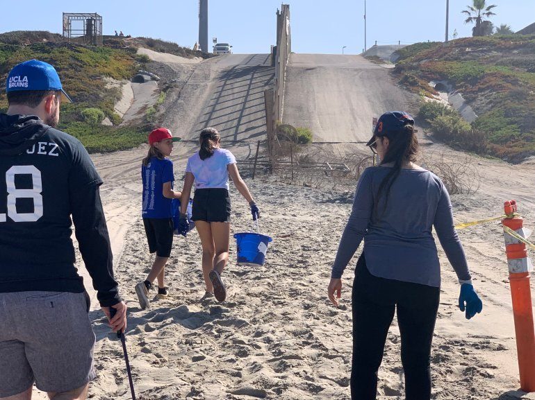 Volunteers picking up trash on Saturday, Sept. 21, 2019, at Imperial Beach, California got too close to an enforcement zone near the border wall. (Border Report Photo/Sandra Sanchez).